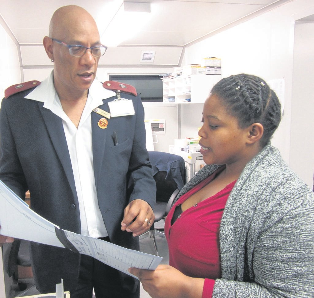 Gregory Paulse, whose body was found in his home on Wednesday 6 February, was lauded for his work as a nurse at the New Mfuleni Community Day Centre. Here he is pictured with local resident, Yonela Sombexe.    PHOTO: Mbongiseni Maseko