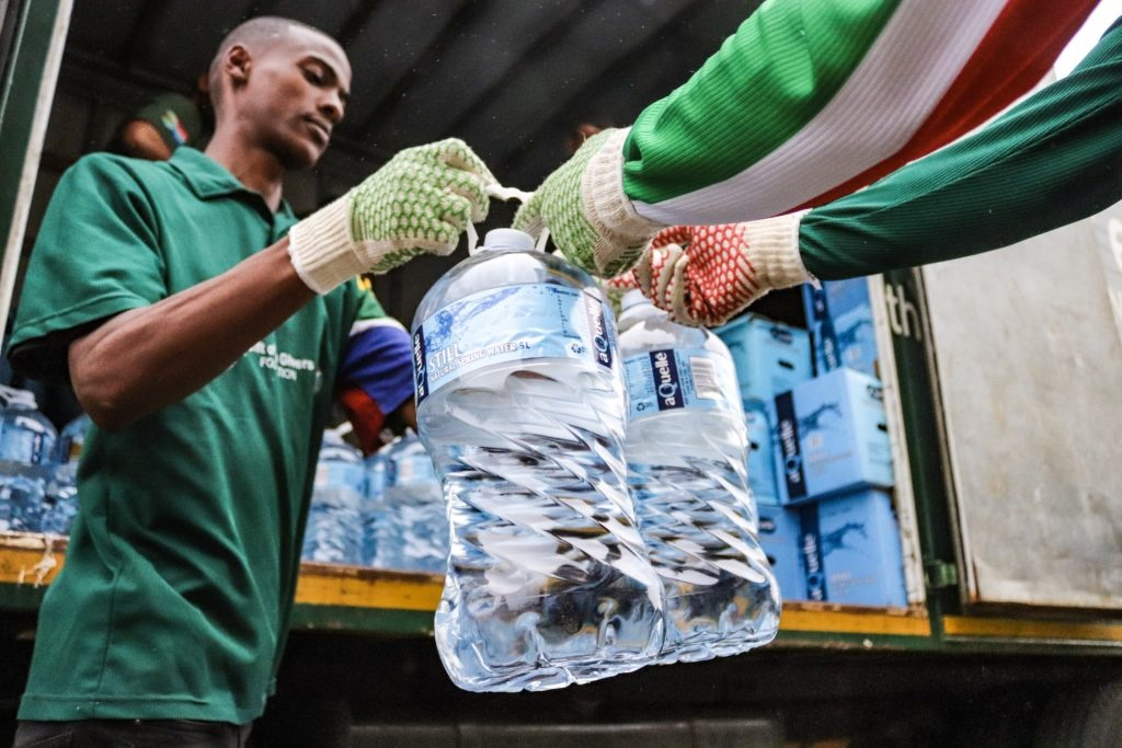 The Gift of the Givers hands out a truck load of water to residents who had gathered in front of the City Hall in Grahamstown. (Stephen Kisbey-Green, Grocott's Mail, file)
