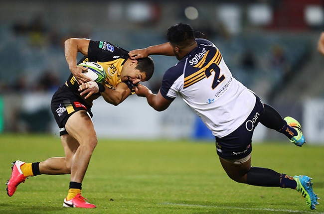 Folau Faingaa of the Brumbies tackles Tomas Cubelli of the Force (Getty)
