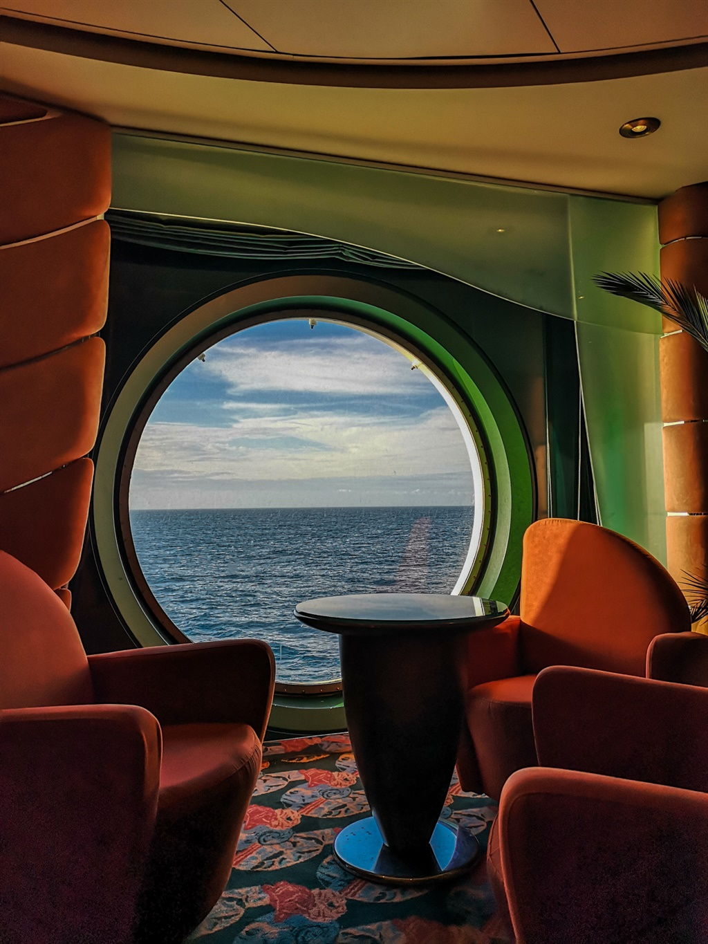 Cruise bar by boat window on sea
