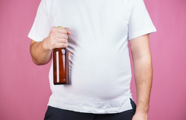 man with beer belly holding beer
