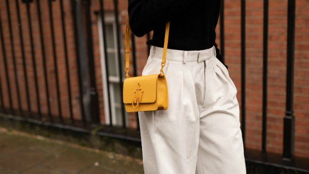 A guest is seen with a JW Anderson bag at London Fashion Week