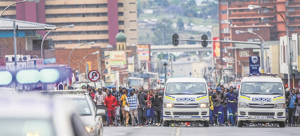 Copesville Community Members protest outside the Pietermaritzburg court yesterday. 15 people from the community were arrested for the recent mob killings.