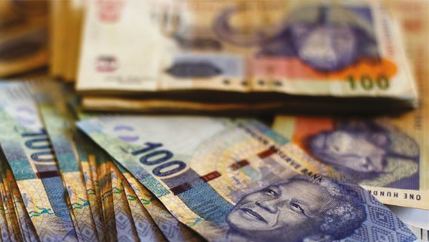 Rand takes further beating after rate cut, falls 2%