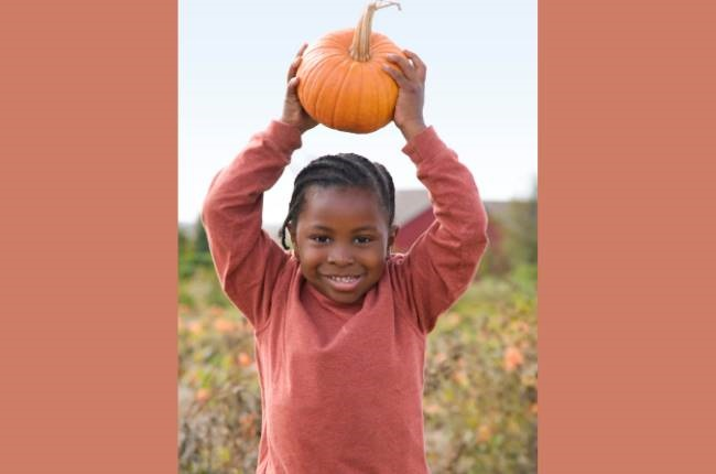 Lindelwe was now able to pick the beautiful golden pumpkin.