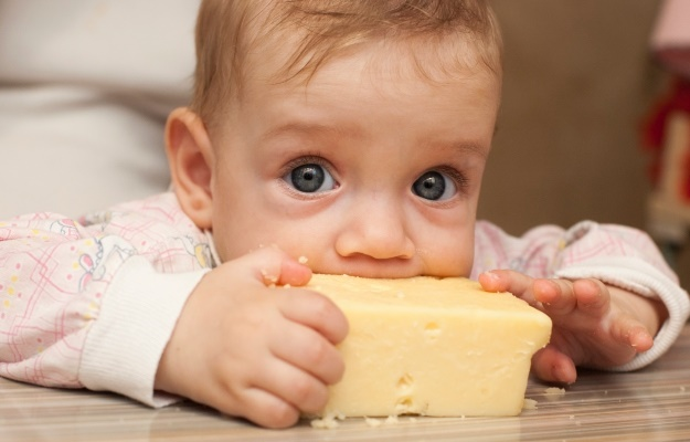 baby eating cheese. (Photo: Getty/Gallo Images)