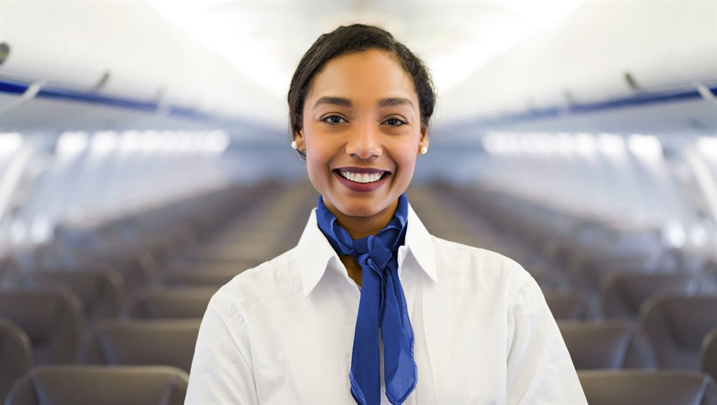 Portrait of a flight attendant in an airplane look