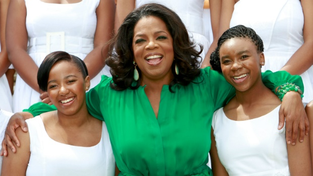 Oprah Winfrey poses with the Graduates on her arri