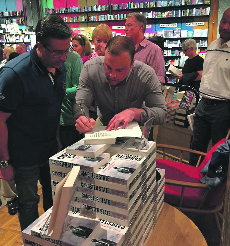 Pieter-Louis Myburgh's book launch ends with a raid by protesters Picture: Maya Fisher-French