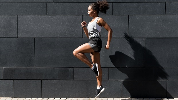 Side view of young woman doing exercising outdoors