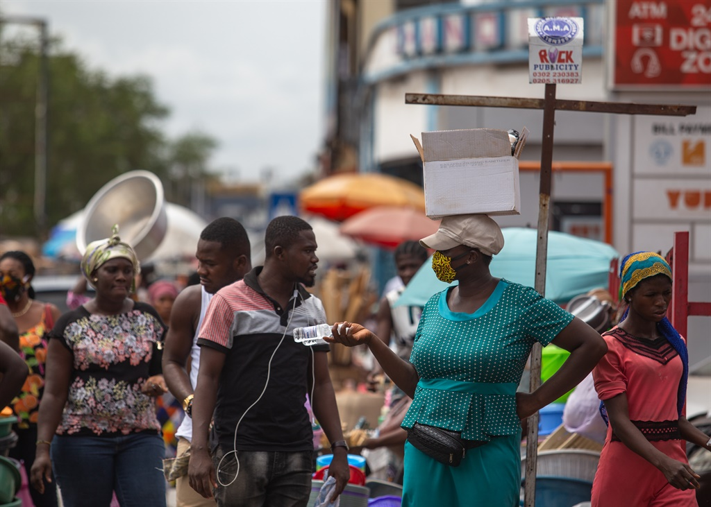 A woman sells hand sanitiser at the Makola Market after the partial lockdown in parts of Ghana to halt the spread of the Covid-19 coronavirus was lifted in Accra, Ghana on 20 April, 2020.