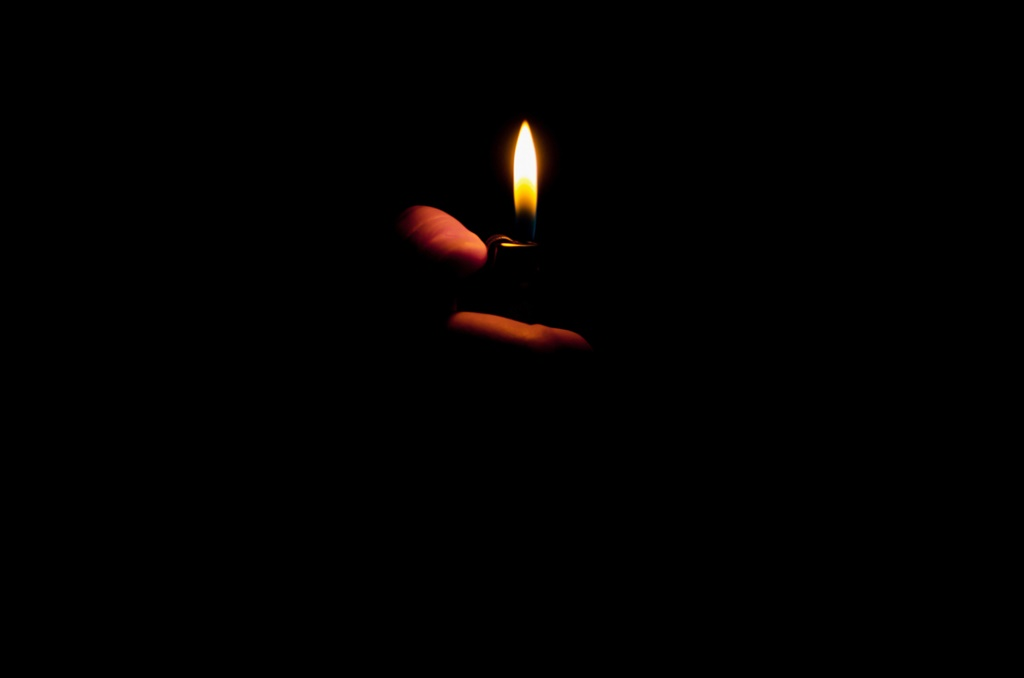 Flame of lighter in black background