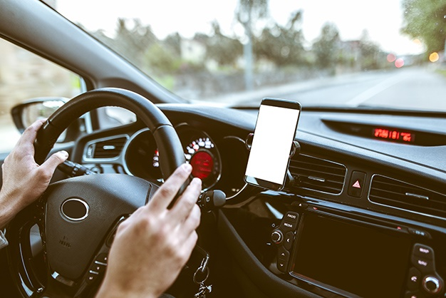 Woman using smart phone as navigation while drivin