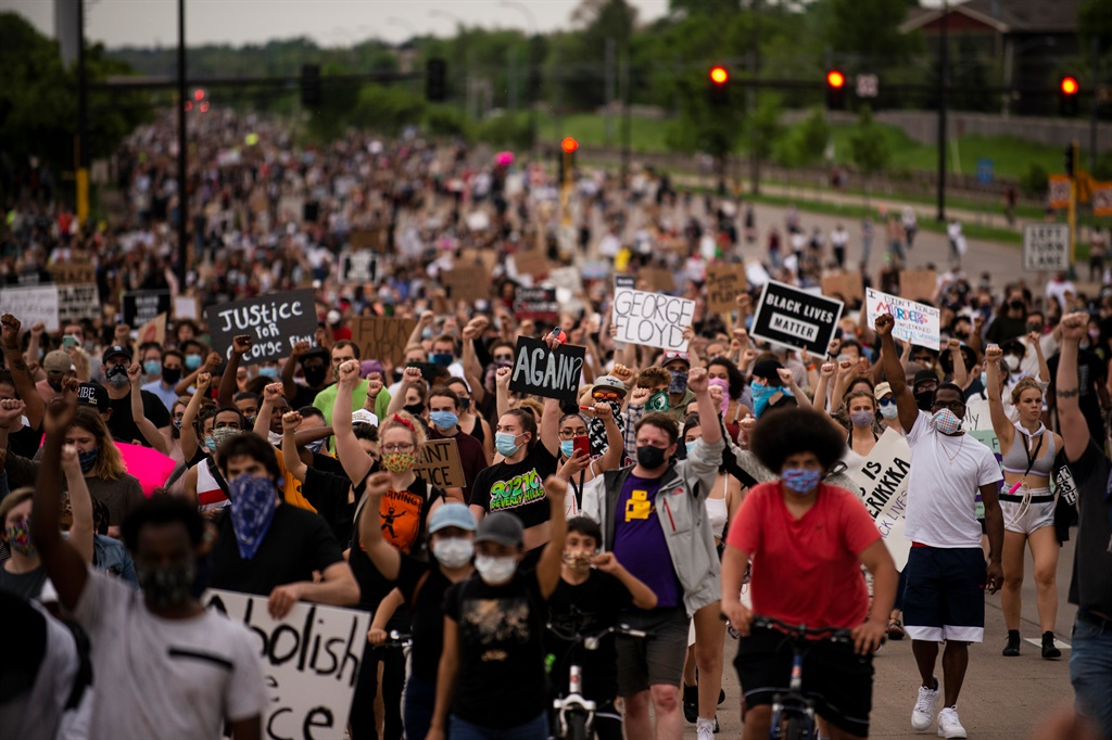 MINNEAPOLIS, MN - MAY 26: Protesters march on Hiaw