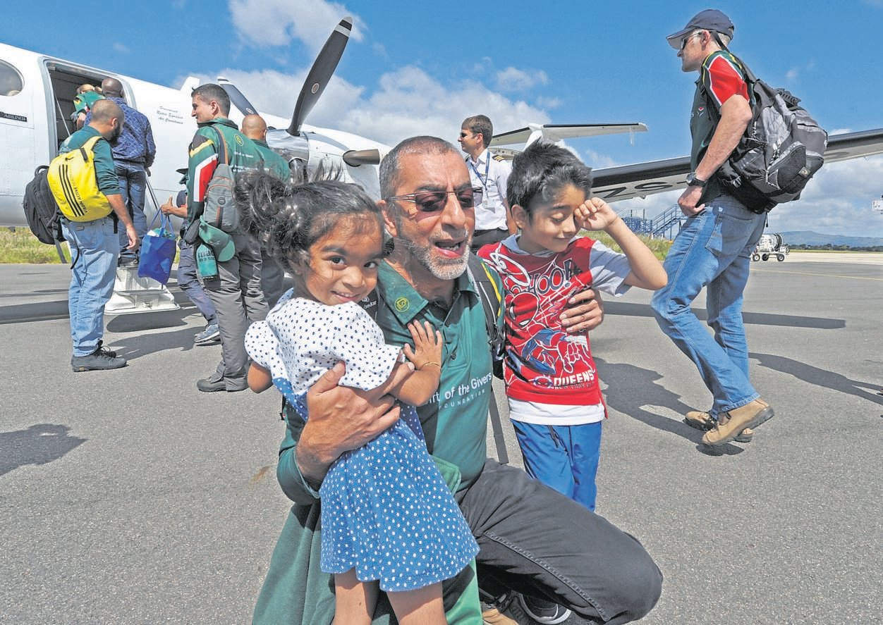 Gift of the Givers' Dr Imtiaz Sooliman embraces his daughter Rahmah (3) and grandson Zuhayr Mahomed (5) before flying out to flood-hit Mozambique with a 10-member medical team made up of Pietermaritzburg paramedics, general practitioners, a neurosurgeon and gynaecologists. The situation in Mozambique