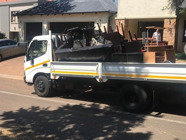 A small truck is seen loaded with furniture taken by the Sheriff from inside a home belonging to Robert Huang inside the Woodhill Golf Estate in Pretoria. (Alex Mitchley, News24)
