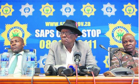 Police Minister Bheki Cele flanked by the MEC for Safety and Security in KwaZulu-Natal, Mxolisi Kaunda (left), and SAPS national commissioner, General Khehla John Sitole, during an update on political killings in Durban.