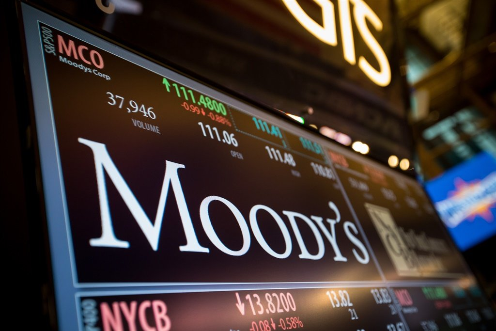 A monitor displays Moodys Corp. signage on the flo