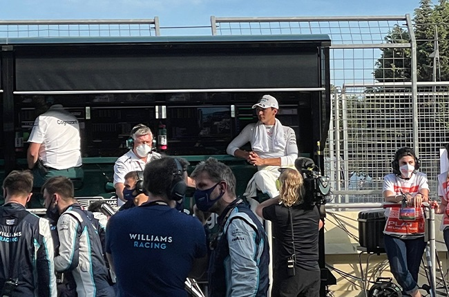 George Russell on the Aston Martin F1 team's pit wall