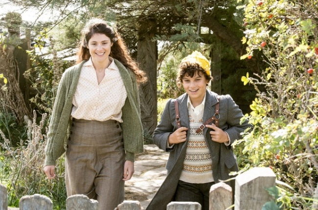 Surly academic Alice (Gemma Arterton) gradually warms to Frank (Lucas Bond), who's sent to stay with her during the Blitz in the film Summerland.