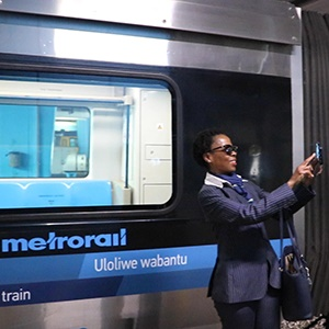 A woman takes a selfie with a newly launched prototype train at Cape Town Station. (Screengrab)