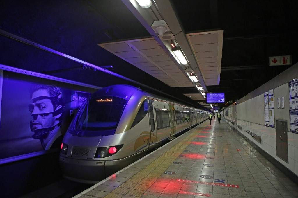 Security officials looks on as the Gautrain leaves the Sandton station. (Phill Magakoe / AFP)
