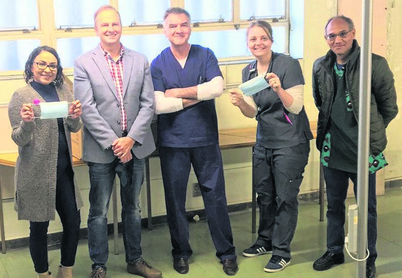 The Raubex Group in Bloemfontein donated Personal Protective Equipment (face masks) to the Netcare Pelonomi Hospital in Bloemfontein. From the left are Dr Alicia Ferris, Jaco Louw (Raubex Group), Dr André Loubser, Dr Alicia Glover and Dr Lincoln John Solomon. Photo: Supplied