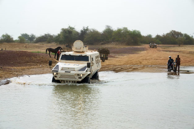 An armoured vehicle of the United Nations Multidimensional Integrated Stabilisation Mission in Mali (MINUSMA) crosses the Niger river. (Michele Cattani/AFP)