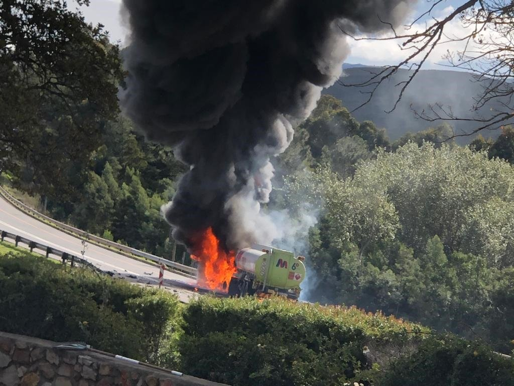 A burning fuel tanker near Grabouw after a car collided with it.