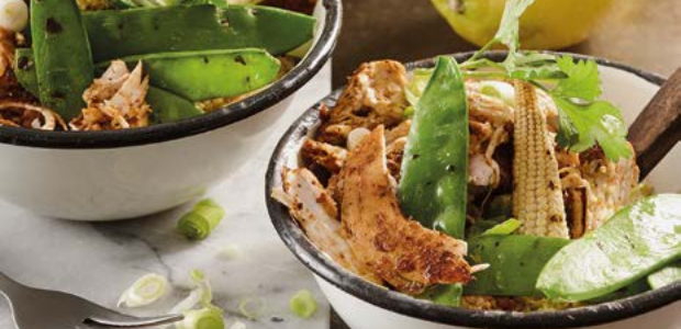 Scrumptious chicken fillets served with seasoned c
