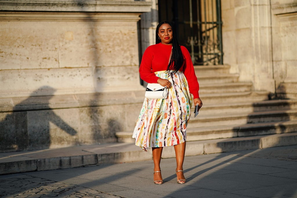 PARIS, FRANCE - MARCH 05: A guest wears a red pull
