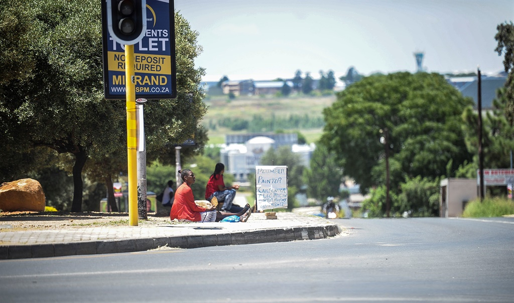 Jobseekers advertise their services in Constantia Kloof, Johannesburg. Picture: Mpumelelo Buthelezi