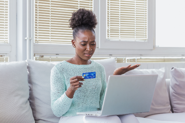 Woman's card declining (PHOTO: Getty Images)