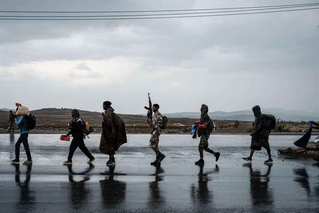 Soldiers of Tigray Defence Force walk in lines towards another field in Mekele, the capital of Tigray region, Ethiopia.