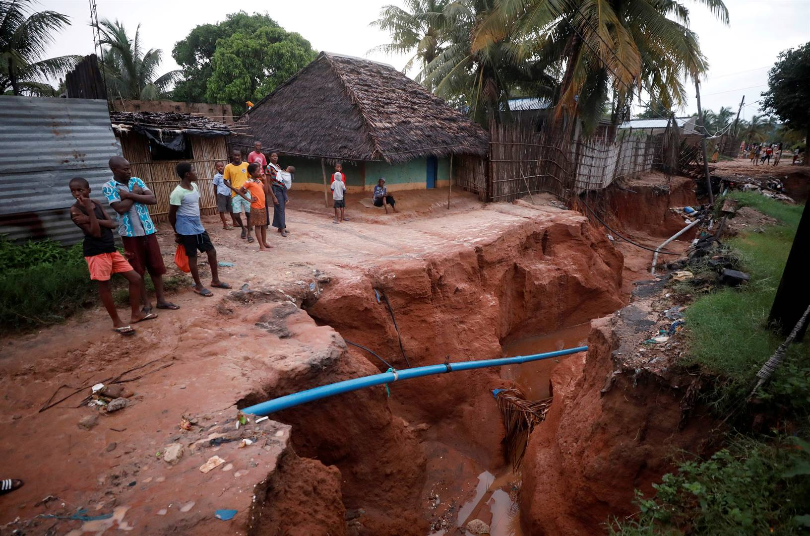 Residents look at a road that collapsed in the aftermath of Cyclone Kenneth, at Wimbe village in Pemba, Mozambique, on Monday (April 29, 2019). Picture: Mike Hutchings/Reuters