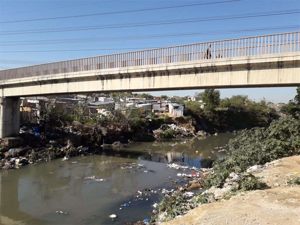 The conditions in Alexandra, where people are living under.