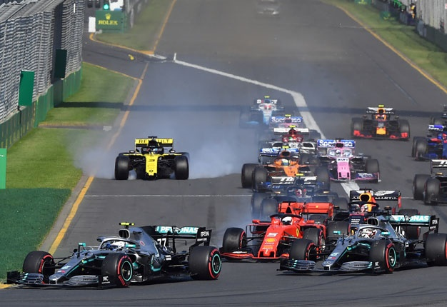 Mercedes Finnish driver Valtteri Bottas (L) leads a pack at the start of the Australian Grand Prix in Melbourne on March 17, 2019. Image: Peter PARKS / AFP