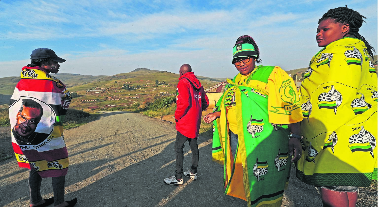 In an area once characterised by political intolerance but now peaceful, ANC and IFP supporters (from left), Fortunate Duma, Nonjabulo Langa and Thabisile Ndlovu walk to vote in Elandskop on Wednesday.