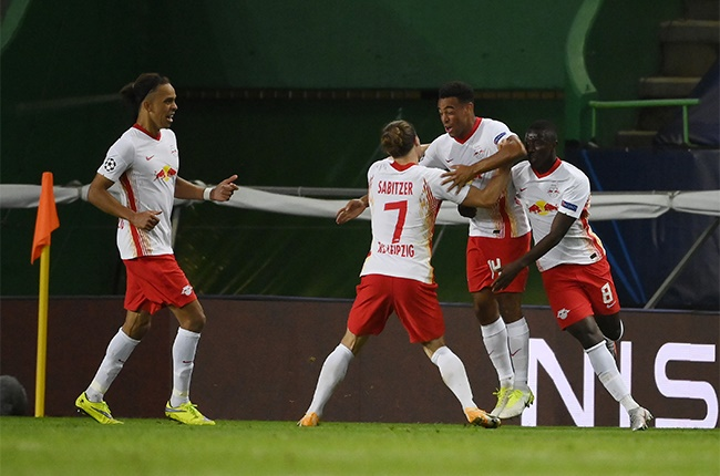 Tyler Adams of RB Leipzig celebrates with teammates after scoring his teams second goal during the UEFA Champions League Quarter Final match between RB Leipzig and Club Atletico de Madrid at Estadio Jose Alvalade on August 13, 2020 in Lisbon, Portugal.