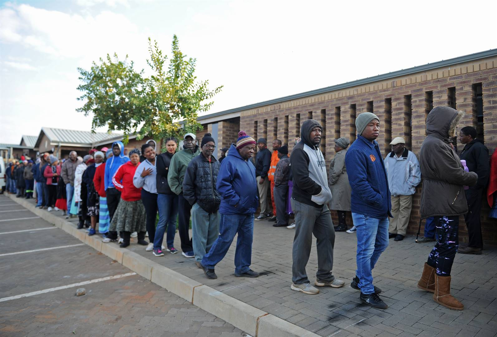 People line up to cast their vote at Moses Kotane primary school in Braamfischerville. Picture: Tebogo Letsie
