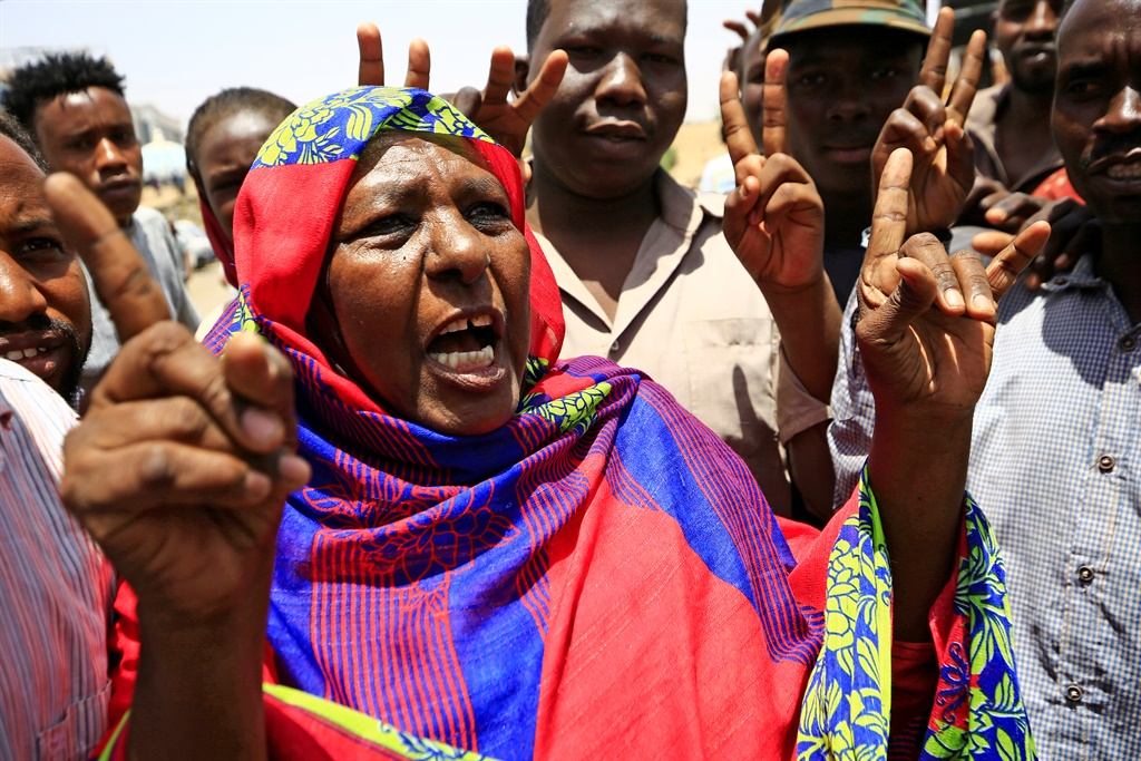 Sudanese demonstrators chant slogans during a sit-in outside Sudan's army headquarters in Khartoum (AFP)