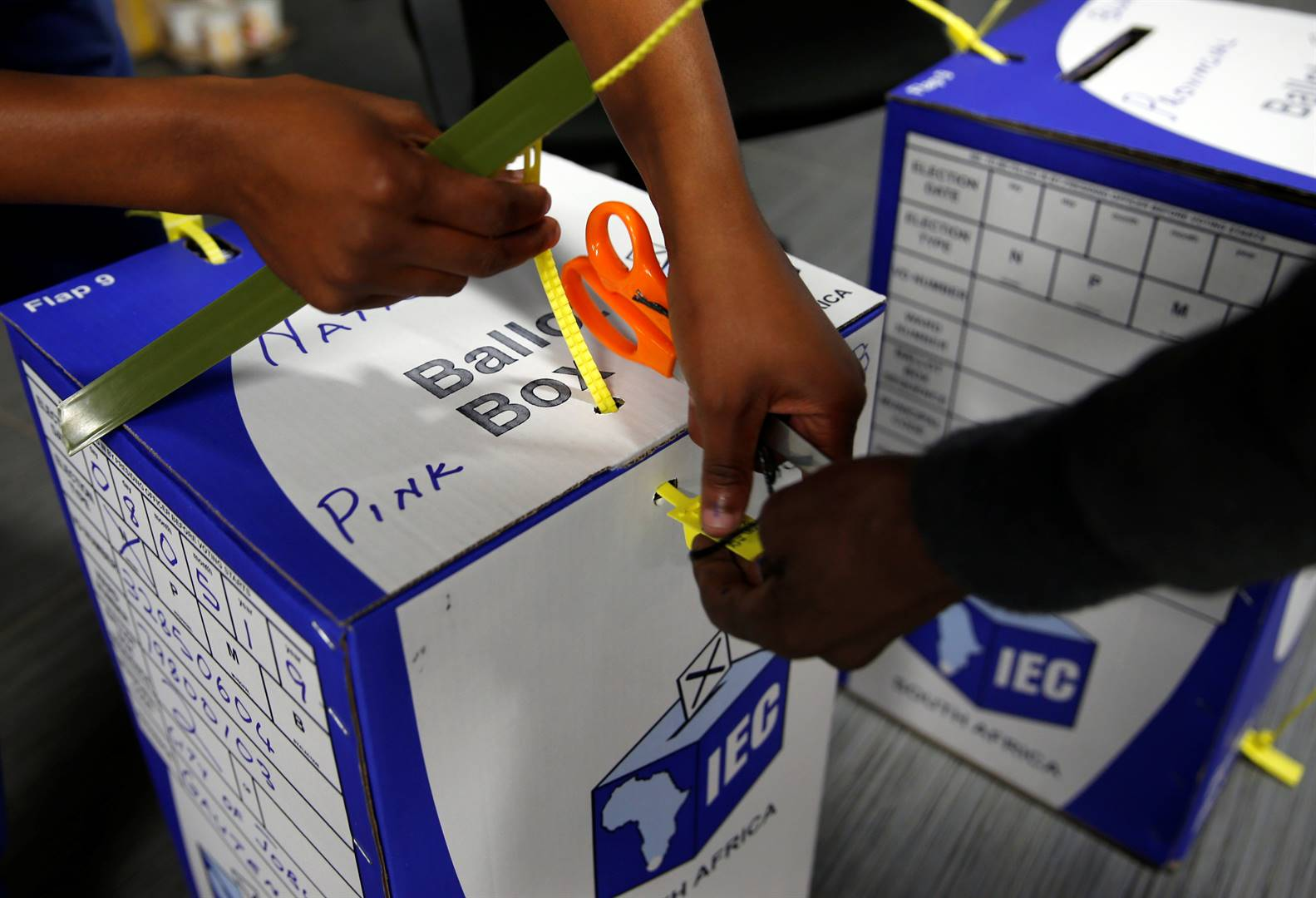 Election officials seal ballot boxes at the end of voting in Johannesburg. Picture: Philimon Bulawayo/Reuters