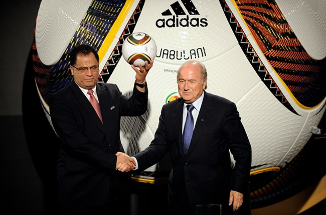 FIFA President Sepp Blatter (R) and CEO of the South Africa 2010 Organizing Committee Danny Jordaan present the official match ball for the FIFA World Cup 2010 on December 4, 2009 in Cape Town, South Africa.
