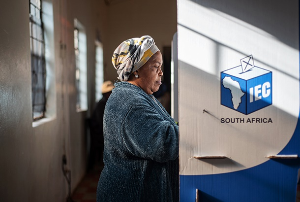 A woman casts her vote for the general elections a