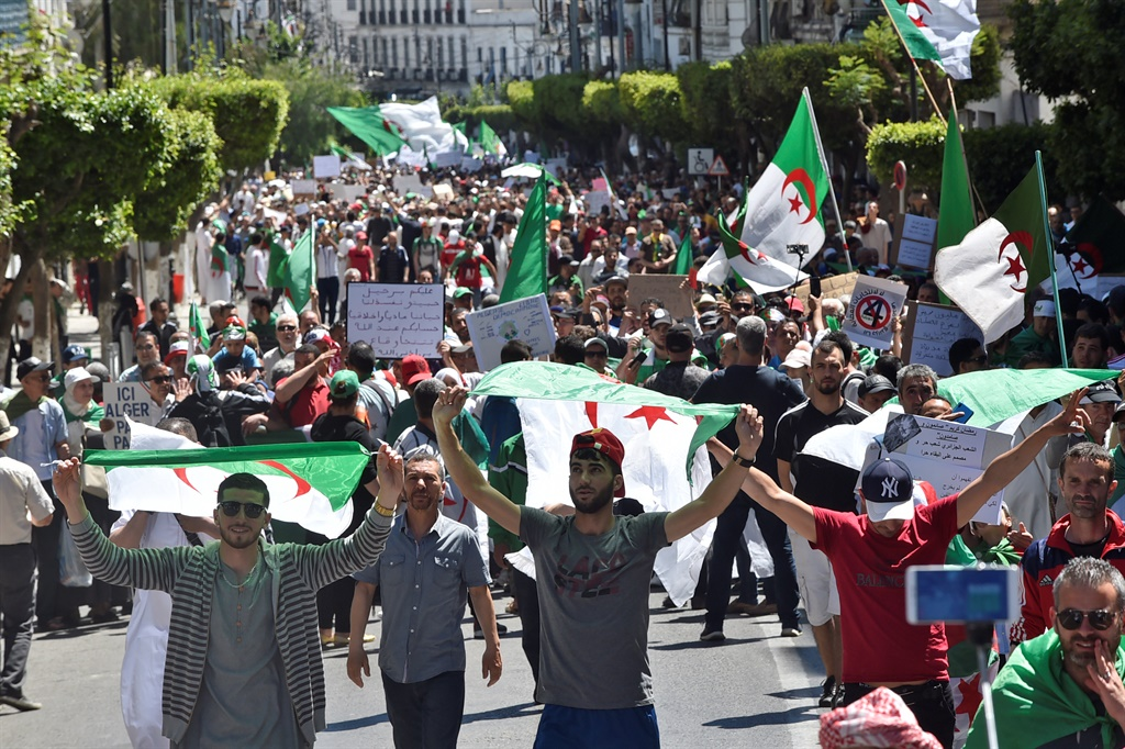 Algerian protesters march with national flags during an anti-government demonstration in the capital Algiers.