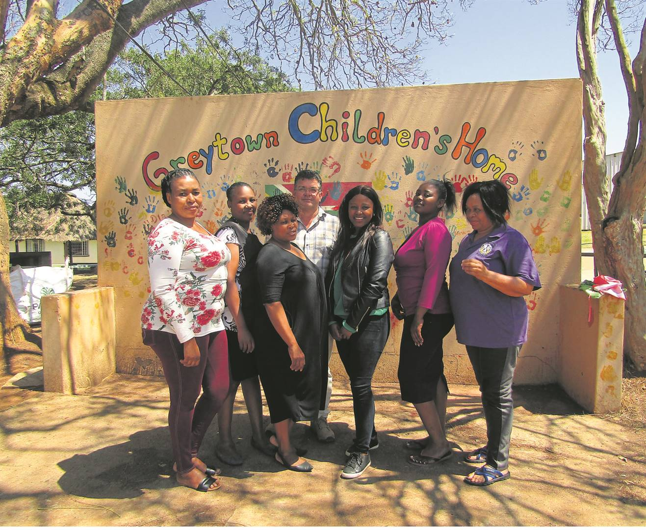PHOTOS: andile sithole Manager of the centre Pieter Swanepoel (back, third from left) with the staff as they celebrate 100 years since the centre was established.