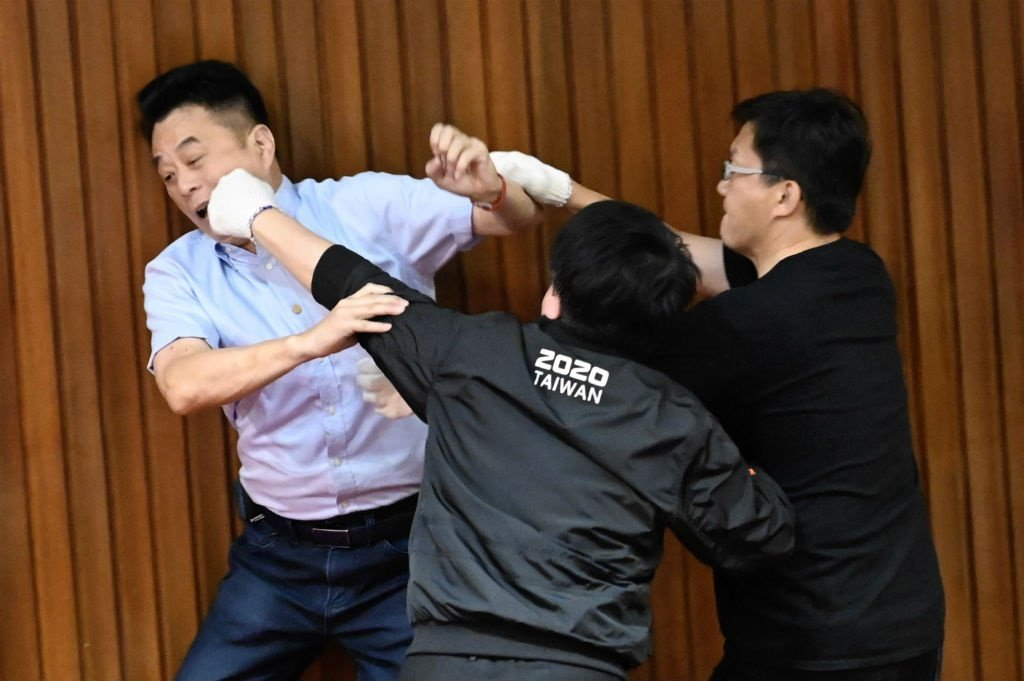 Taiwan's main opposition Kuomintang (KMT) legislator Lu Ming-che (L) fights with ruling Democratic Progressive Party (DPP) lawmaker Wu Ping-jui (C) as scuffles broke out during voting at the parliament in Taipei on 17 July 2020.
