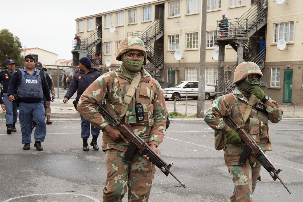 Members of SANDF in Manenberg. (Rodger Bosch, AFP)