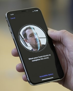 An Apple employee demonstrates the facial recognition feature of the new iPhone X. (Eric Risberg, AP File)