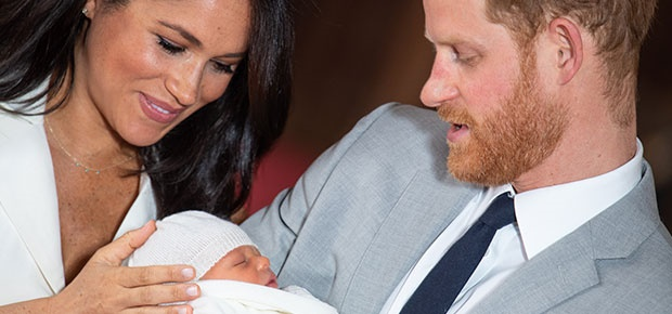 Meghan and Prince Harry pose with their newborn so